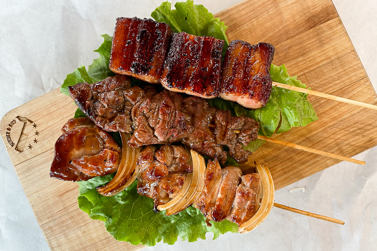 Grilled meat on sticks.
