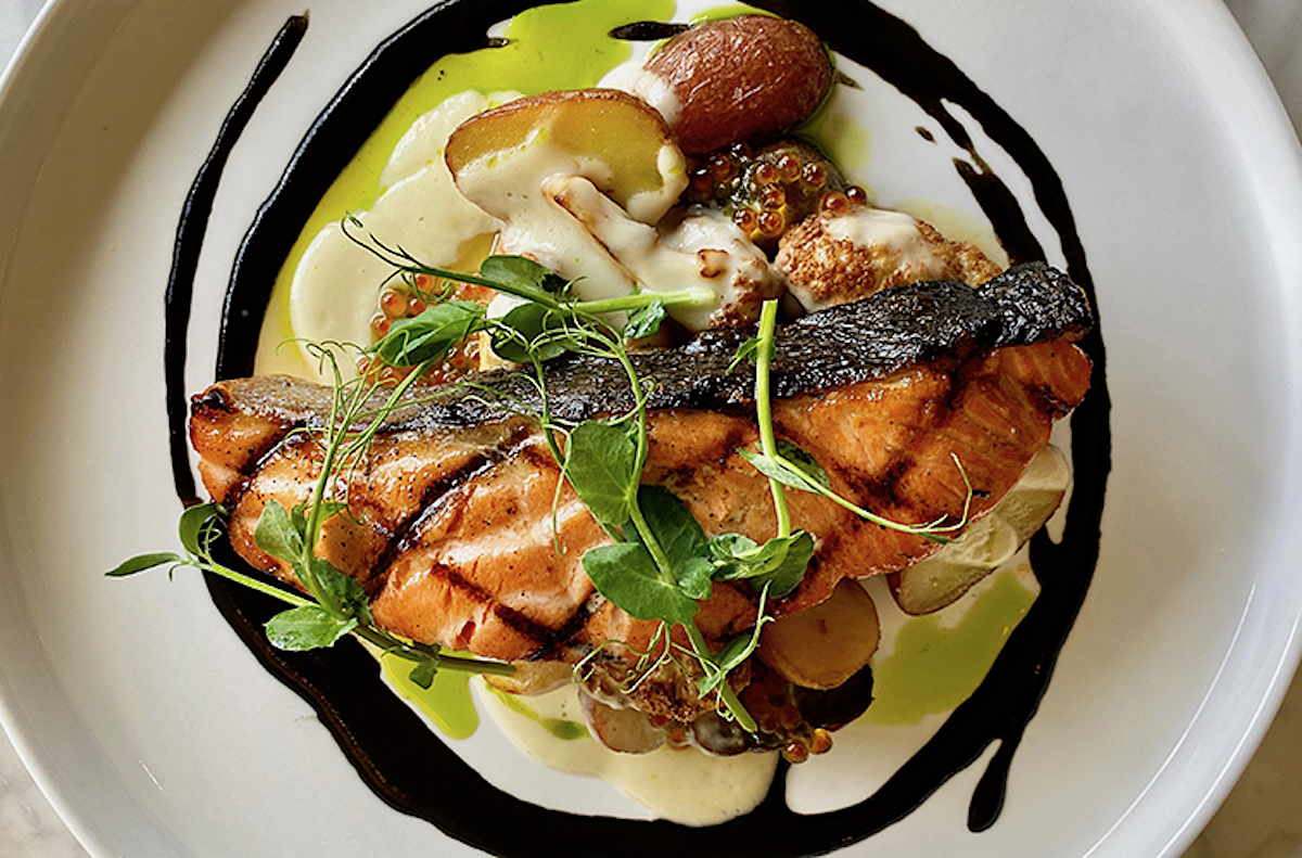 grilled salmon fillet atop fingerling potatoes, ringed with tsukudani sauce