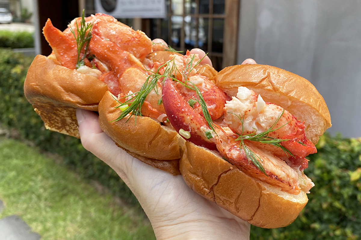 Lobster claw and knuckle meat overflowing a King's Hawaiian sweet roll bun
