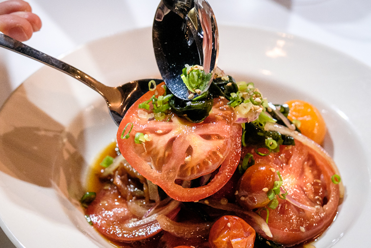 bright red tomatoes twined with wakame seaweed