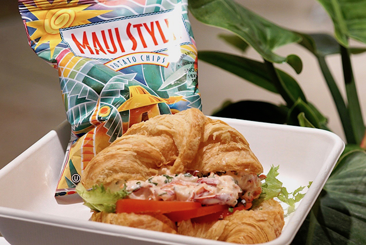 croissant stuffed with lobster salad, with a bag of maui style potato chips