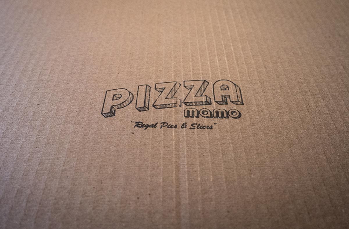 Pizza Mamo logo on a takeout box