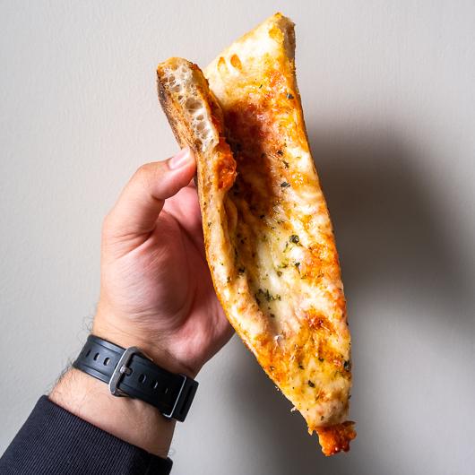 brooklyn-style pizza slice, folded in half