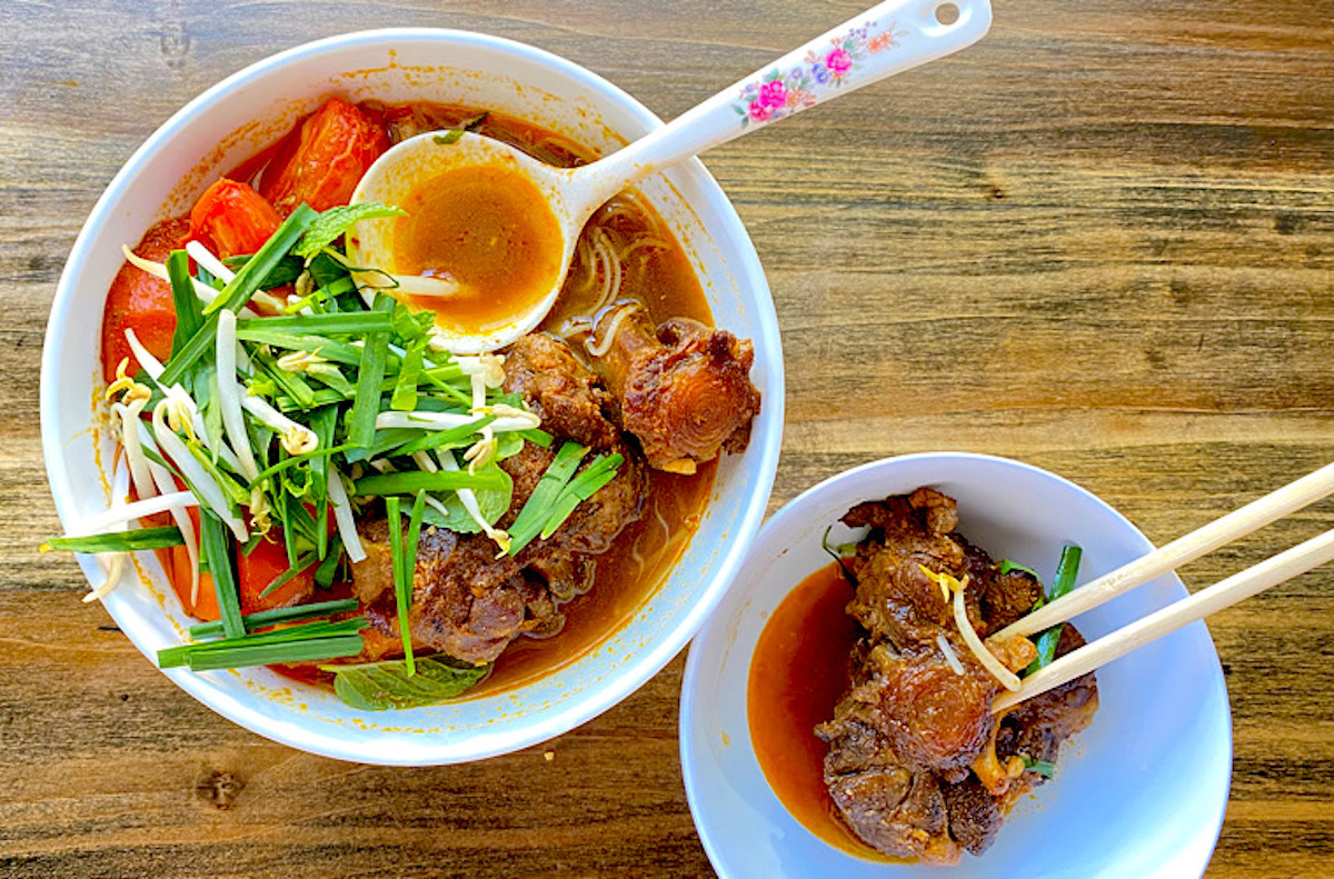 meaty oxtail rounds top a rich red vietnamese stew with carrots and tomatoes