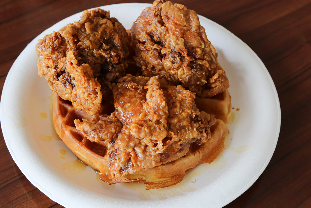 If you're looking for some seriously tasty fried chicken and waffles, look no further than the 3 piece honey butter chicken and waffles meal at Pancakes and Waffles ($11.49). Photo by Grant Shindo
