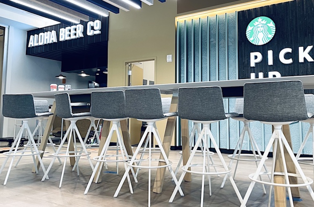 new Aloha Beer Downtown kiosk with row of sleek counter stools in foreground