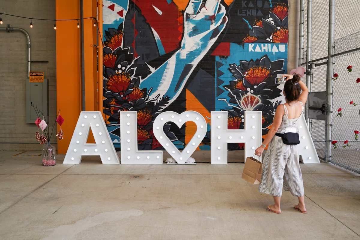 Share Aloha Woman Taking Photo