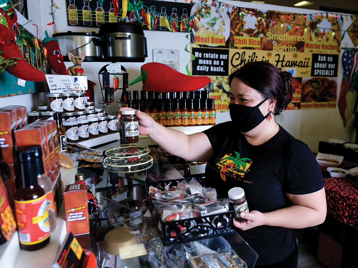 Owner Bev Matsuura Stocking The Shelves Of Her Store Chili In Hawaii