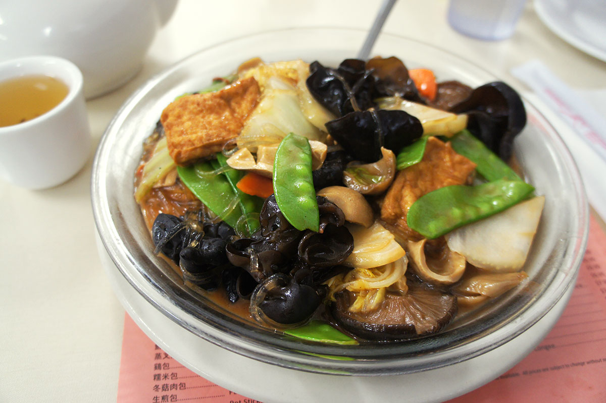 a wealth of colorful ingredients fill a bowl of vegetarian jai